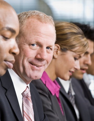 Businessman Smiling During Meeting